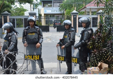 TARAKAN,Indonesia-April 7, 2016. police guard on demonstration of the electricity crisis at the building of parliament in Tarakan city