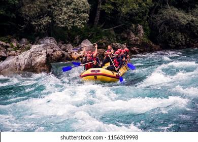 Tara,Montenegro - June 14 2018 - Group of people in a rafting boat,beautiful adrenaline ride down the river