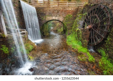 Taramundi, Spain - November 19, 2018: water mill museum in autumn scenary, Taramundi, Galicia, Spain