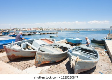 Taranto, Apulia, Italy - MAY 31, 2017 - Native fishermen working on their boats