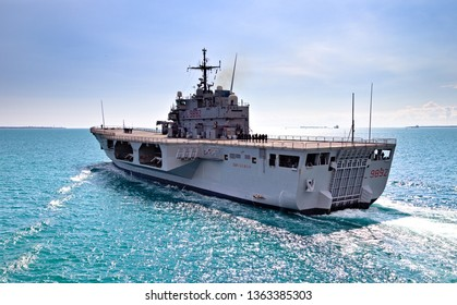 Taranto, Italy - April 07, 2019: the Italia Navy military ship San Giorgio is coming out of the Mar Piccolo of Taranto to go on a mission in the Mediterranean Sea