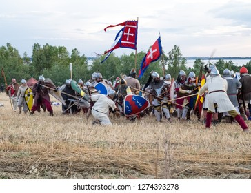 Taranto, Italy - circa June 2018: Clash between soldiers in medieval costume and historical weapons for the conquest of southern Italy disputed between the Normans and the Byzantines.