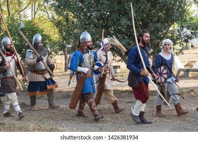 Taranto, Italy-June 15, 2019: Historical re-enactment of the 11th century battle in southern Italy between byzantines and Normans, armed troops in medieval costumemarch march to the battlefield.