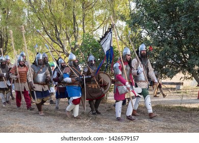 Taranto, Italy-June 15, 2019: Historical re-enactment of the 11th century battle in southern Italy between byzantines and Normans, armed troops in medieval costume march to the battlefield.