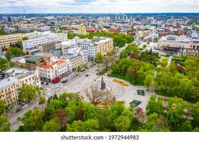 Taras Shevchenko monument at Sumskaya street in Kharkov, Ukraine. Aerial view with green spring trees in park
