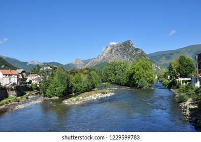 TARASCON, FRANCE - September 8, 2018. River Ariege and surrounding hills, Tarascon-sur-Ariege, Ariege, Occitanie, France