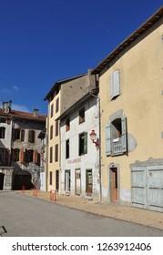 TARASCON, FRANCE - September 8, 2018. Shuttered buildings including a boulangerie, Place Felix Garrigou, Tarascon-sur-Ariege, Ariege, Occitanie, France