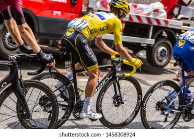 Tarascon-sur-Ariege, France - July 21, 2019: The French cyclist  Julian Alaphilippe of Team Deceuninck-Quick Step, in Yellow Jersey riding in the peloton during the stage 15 of Le Tour de France  2019