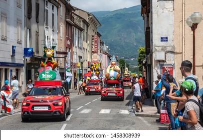 Tarascon-sur-Ariege, France - July 21, 2019: The caravan of Parc Asterix driving in The Publicity Caravan, in Tarascon-sur-Ariege, before the stage 15 of Le Tour de France  2019.
