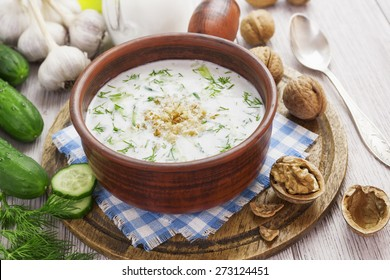 Tarator, bulgarian sour milk soup in an orange bowl
