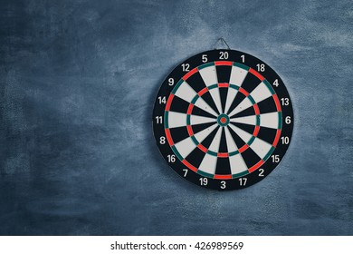 Target aim, symbol of goal  ,The game of darts target on wall