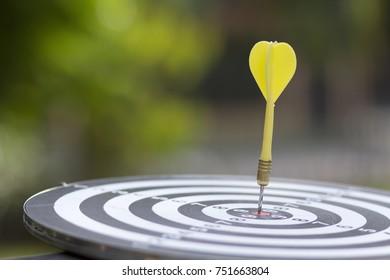 Target arrow green background  ,metaphor to target marketing concept.