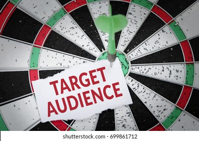 Target audience note on notepaper with dart arrow and dart board. Marketing, advertisement, business concept.