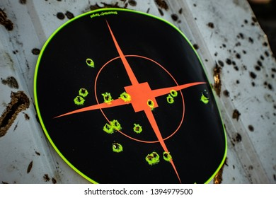 Target with bullet holes on wood