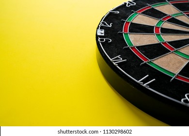 Target dart board on the yellow background, center point, head to target marketing and business concept