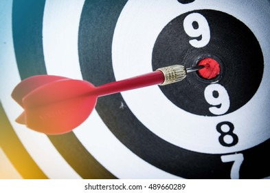 target dart with wood background