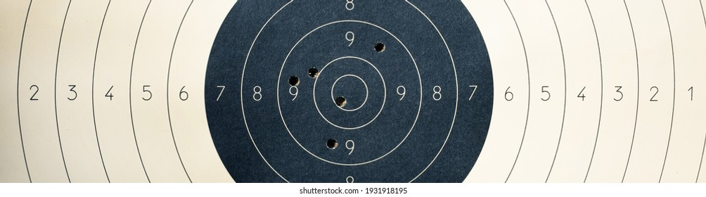 Target with numbers for shooting at a shooting range. A round target with a marked bull's-eye for shooting practice on the shooting range. Target with bullet holes