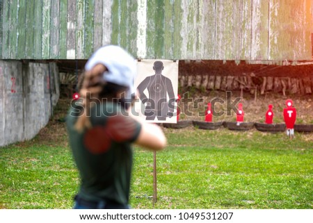 aaafc312dc758 Target practice shooting in aim of woman shooting riffle, arm and weapon  martial art for