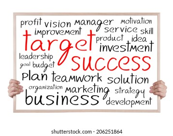 target and success and other related words handwritten on whiteboard with hands