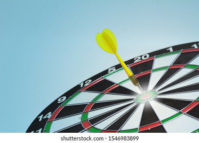 Targeting with arrows on  soft, blurred background compared to target marketing concept.