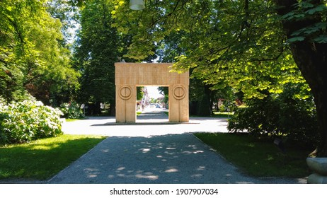 Targu Jiu, RO - June 20, 2020: Gate of the Kiss from the Sculptural Ensemble of Constantin Brancusi. Homage to the Romanian heroes of the First World War. Colorful summer view of UNESCO heritage site