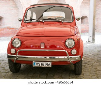 TARGU MURES, ROMANIA 13 May 2016: Red classic Fiat 500 in Vintage Cars Parade Festival 2016 in Targu Mures, Romania