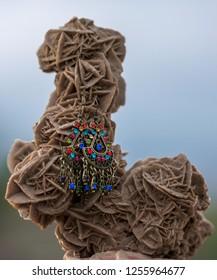 targui earrings exposed on a desert rose in algeria,