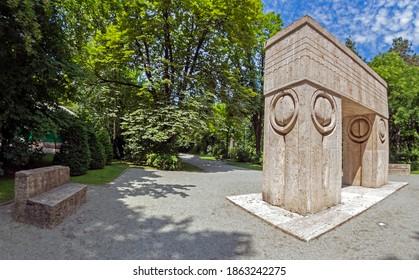 TARGU-JIU, ROMANIA - JULY 23, 2020: Kissing Gate, symbolize the triumph of life over death. The sculpture is part of the Sculptural Ensemble of famous sculptor Constantin Brancusi at Targu Jiu.