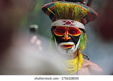 Tari, Papua New Guinea - August 2, 2018: A Papua New Guinea highlands tribesman attending an Asaro Mudman ceremony.