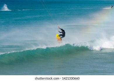 Tarifa, Andalusia/ Spain. December 21. 2017. Kitesurfer, jumping over wave in Tarifa.