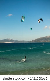 Tarifa, Andalusia/ Spain. December 21. 2017. Kitesurfers, wave riding, in Tarifa,