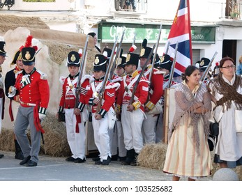TARIFA, ANDALUSIA, SPAIN - MAY 18 : reenactment of the Siege of Tarifa during the independence wars in Spain in the year 1812 reenacted by british soldiers, marching into battle,  May 18, 2012 in TARIFA, ANDALUSIA, SPAIN