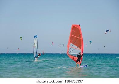 Tarifa, Cadiz/ Spain. july 21 2014: Kitesurfers and windsurfers on the beach at Ensenada de Bolonia, Costa de la Luz, Tarifa, Spain