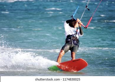 TARIFA, SPAIN – AUGUST 26. Kite boarder sailing across the Los Lances Beach in the west coast of Tarifa Village, on August, 2018 in Cadiz.