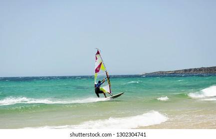 Tarifa, Spain - Jul 16, 2014: Windsurfing in Bolonia beach, one of the famous beaches of Tarifa, Costa de la Luz, Cádiz, Spain