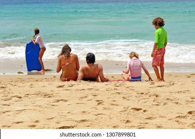 Tarifa, Spain - Jul 27, 2012: a family  in the beach of Bolonia near Tarifa, one of the most beautiful beaches on the coast of Cadiz, Andalusia and Spain