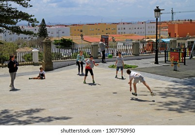 Tarifa, Spain - May 7, 2018: children are playing dodge ball game outdoor in Tarifa, Spain