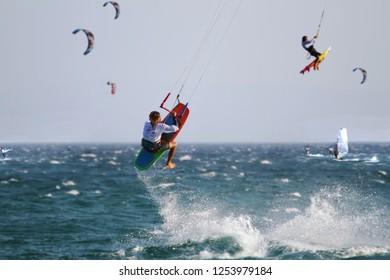 TARIFA, SPAIN – SEPTEMBER 08, 2018. Windsurfer sailing fast and jumping across the Los Lances Beach in the west coast of Tarifa Village, in Cadiz.