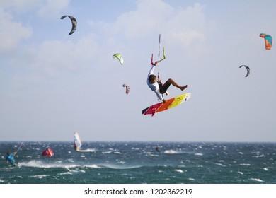 TARIFA, SPAIN – SEPTEMBER 30. Kitesurfer jumping in the beach of Tarifa in Spain on September 30, 2018 in Cadiz.