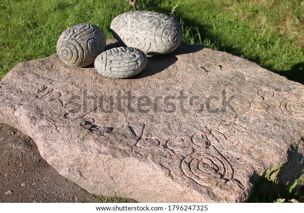 Tarland, Aberdeenshire, Scotland, 15/08/2020: Carved oblong stones, similar design to Towie balls