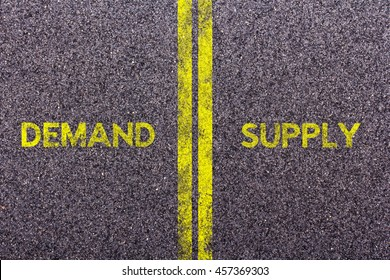 Tarmac background with the words demand and supply