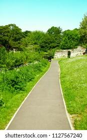 A tarmac path through Suffolk countryside