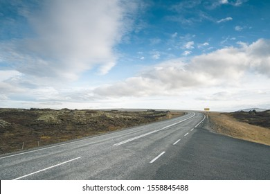 Tarmac scenic road at Iceland. Beautiful landscape, cloudy blue sky. Backplate.