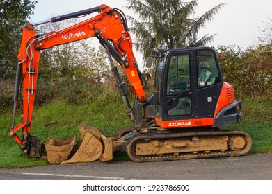Tarn, France - Dec. 2020 - Detail of the rear of a compact mini excavator from the Japanese manufacturer of constrcution equipment Kubota, equipped with a mechanical arm actuated by hydraulic hoses
