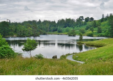 TARN HOWS, UNITED KINGDOM -25 JULY 2016- Tarn Hows, a picturesque outdoor area in the Lake District in Cumbria including a tarn, waterfalls, and hiking trails, is managed by the National Trust.