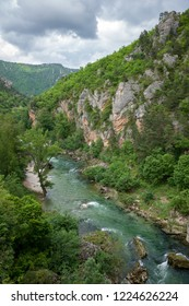 Tarn river flowing through the steep cliffs of the Gorges du Tarn Aveyron France