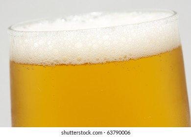 tarnished glass of beer with foam