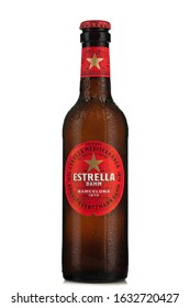 TARNOW, POLAND - FEBRUARY 01, 2020: Bottle of Cold Estrella  Beer. Spanish Estrella Brand Are Increasingly Popular .