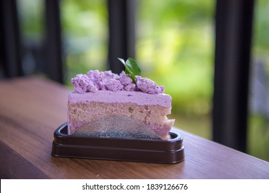 Taro flavor cake on the table in cafe.