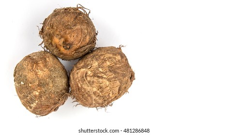 Taro roots over white background